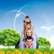 Collage with children and parents on green grass — Stok fotoğraf