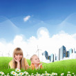Collage with children and parents on green grass — Stock Photo #7741633