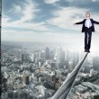 Business man balancing on the rope — Stock Photo #7741896