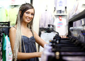 Young girl buying clothes — Stock Photo