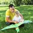 Father with his son in the park - Stock Photo