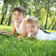 Two brothers together in the park - Stock Photo