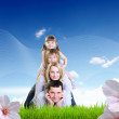 Collage with children and parents on green grass — Stockfoto