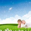 Royalty-Free Stock Photo: Collage with children and parents on green grass
