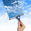 Window with blue sky and white clouds - Stock Photo