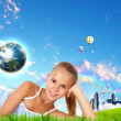 Smiling girl on green grass - Stock Photo