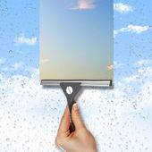 Window with blue sky and white clouds — Stok fotoğraf
