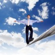 Business man balancing on the rope — Stock Photo #7928581