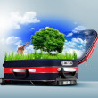 Red suitcase with green nature inside - Stock Photo