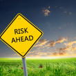 Road sign warning about risk ahead - Stock Photo