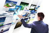 Man working with vurtial screens — Stock Photo