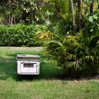 Beehive in a tropical garden in Thailand. - Stock Photo