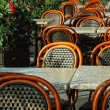 Tables and chairs in an outdoor cafe — Stock Photo