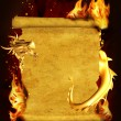 Dragon, fire and scroll of old parchment — Stock Photo #7600305