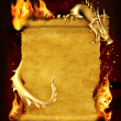 Dragon, fire and scroll of old parchment — Stock Photo #7697344