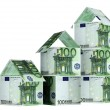 Houses from euro banknotes - Stock Photo