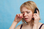 Portrait of Woman crying with phone call — Stock Photo