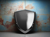 Illuminated steel shield — Stock Photo