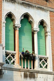 Old green lancet Venetian window,Italy — Stock Photo