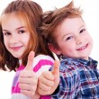 Happy boy and girl  thumbs up — Stock Photo