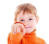 Boy pointing with finger against a white background — Stock Photo