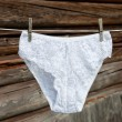 White feminine panties on rope - Stock Photo
