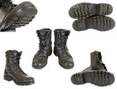 Old black army boots on white background — Stockfoto