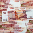 Money background of russiroubles. Banknotes one thousand rub — Stock Photo #7042878