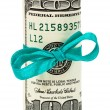 100 US dollar wrapped by ribbon isolated on white background — Stock Photo #7067171