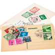 Postage stamps and postage cards on white background — Stock Photo
