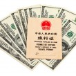 Chinese Travel permit and US dollars over white — Stock Photo