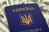 Ukrainian passport on US dollars background — Stock Photo