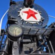 Old steam locomotive with red star — Stock Photo #7901902