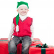 Christmas toddler with presents — Stock Photo