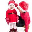 Santa mother and daughter in studio — Stock Photo