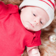 Newborn baby in chritstmas hat — Stock fotografie