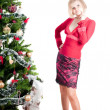 Happy woman with Christmas presents — Foto de stock #7215480