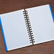 Notepad on a wooden table — Stock Photo #7888699