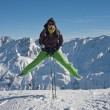 Woman in ski cloths jumping over the snowy mountains, austria — Stock Photo #6818004