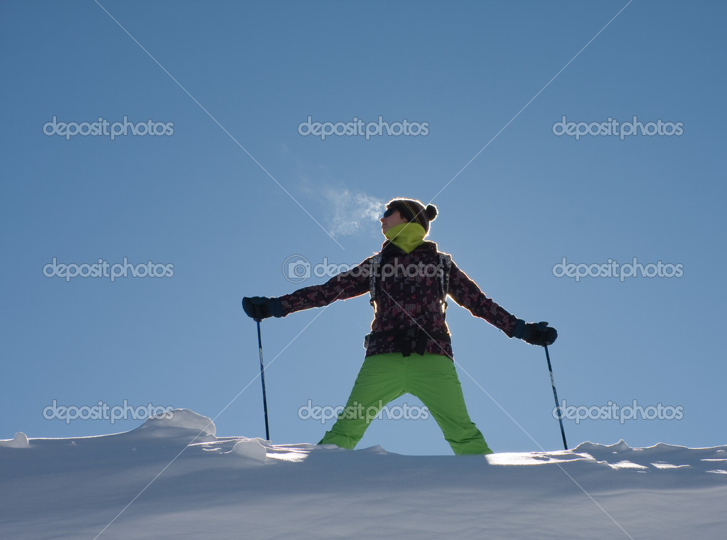A girl in a ski suit against the sky  Stock Photo #7050466