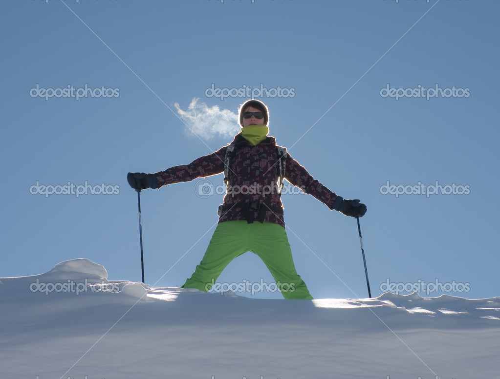 A girl in a ski suit against the sky — Stock Photo #7050474