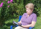 A woman with an e-book — Stock Photo