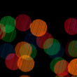 Color Bokeh against a dark background. — Stock Photo #7244243