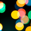 Color Bokeh against a dark background. — Stock Photo #7244337