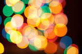 Color Bokeh against a red background. — 图库照片