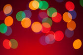 Color Bokeh on a red background. — Foto de Stock