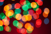 Color Bokeh on a red background. — Stock Photo
