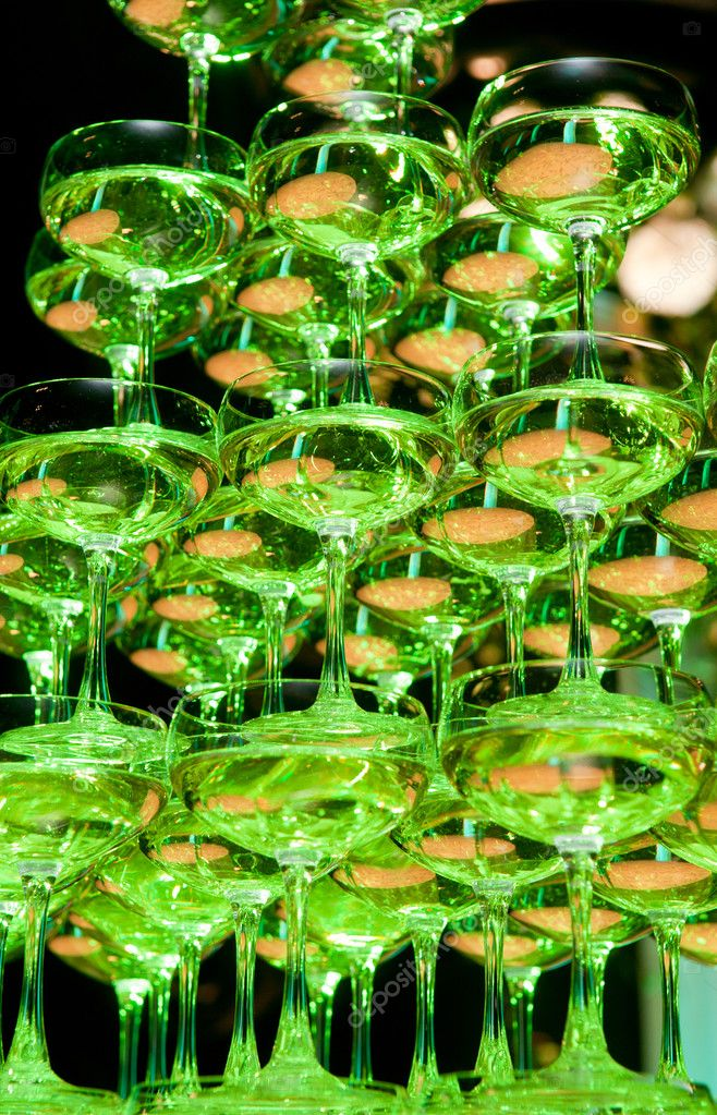 Pyramid of champagne glasses, a black background — Stock Photo #6883613