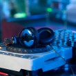 Dj mixer with headphones at a nightclub — Stock Photo