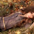 Woman lying on the leaves — Stock Photo